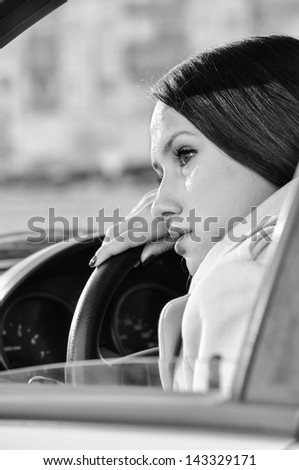 beautiful woman is resting in a car - stock photo