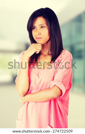 Beautiful woman is thinking about an idea - stock photo