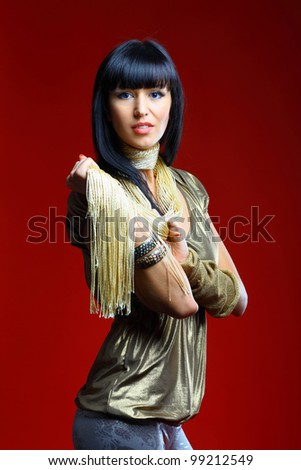 Beautiful woman isolated on a dark red - stock photo