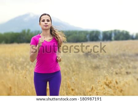 Beautiful Woman Jogging outdoors - stock photo