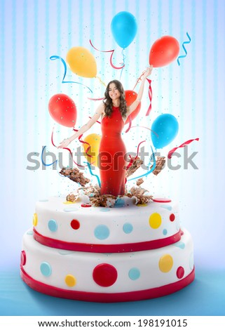 Beautiful woman jumping out of the cake - stock photo