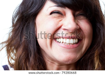 Beautiful woman laughs out loud with joy - stock photo