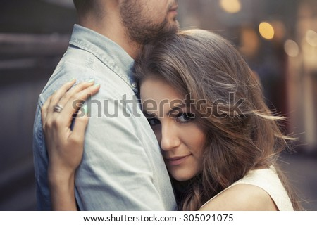 beautiful woman laying her head on man's chest - stock photo
