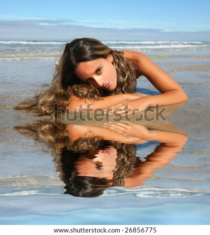 beautiful woman lays on beach - stock photo