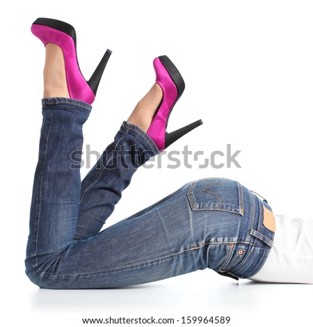 Beautiful woman legs with jeans and fuchsia high heels lying down isolated on a white background           - stock photo