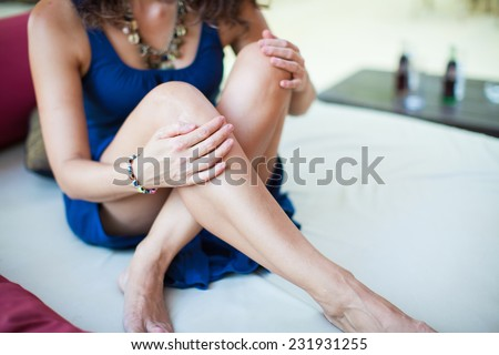 Beautiful woman legs. Young woman resting. Charming woman in a restaurant. Beautiful woman at cafe restaurant lifestyle portrait, summer vacation of sexy young girl. - stock photo