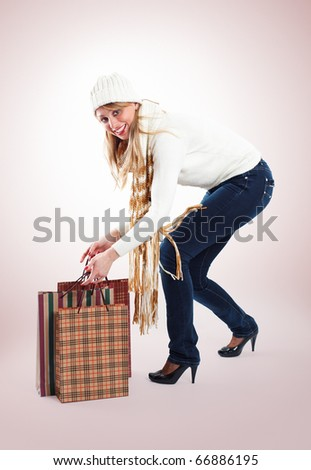 Beautiful woman lifted bags after winter shopping