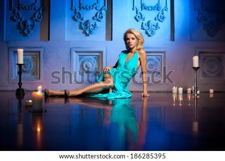 Beautiful woman like a princess in the palace. Luxurious rich fashion stylish girl in a long evening dress. - stock photo