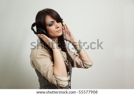Beautiful woman listening music - stock photo