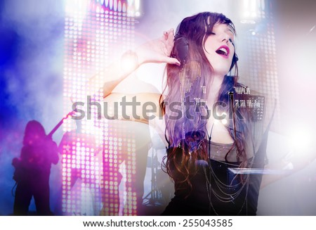 Beautiful woman listening music with live band background. Concept background of live music and party - stock photo