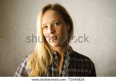 Beautiful woman listening to music - stock photo