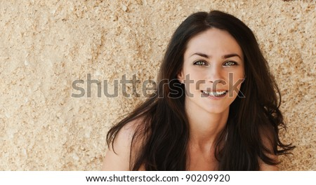 beautiful woman long dark hair bare shoulders - stock photo