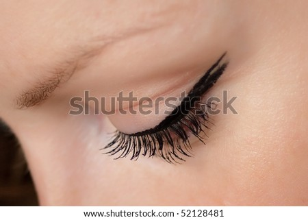 Beautiful woman look down with fluffy eyelash - stock photo
