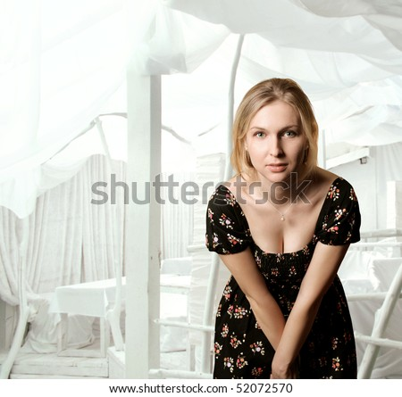 Beautiful woman looking at camera - stock photo
