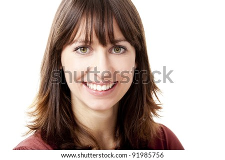 Beautiful woman looking at camera and smiling, isolated on a white background