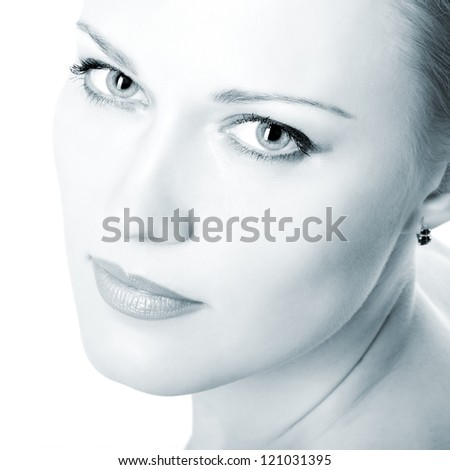 beautiful woman looking at camera, mid adult female face closeup, isolated on white background toned blue