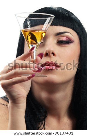 Beautiful woman looking at glass of cocktail - stock photo