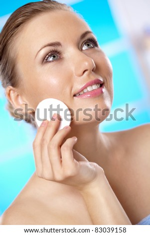 beautiful woman looking at herself in the mirror - stock photo