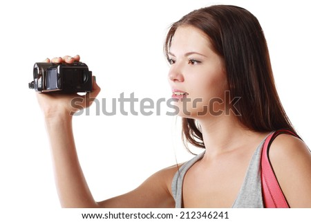 beautiful woman looking at videocamera shooting something outside te picture - stock photo