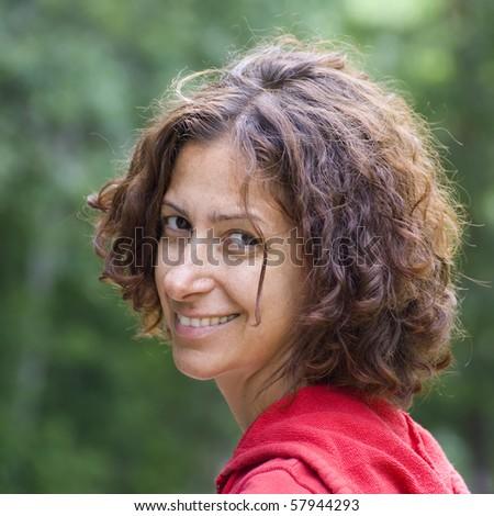 Beautiful woman looking at you. - stock photo