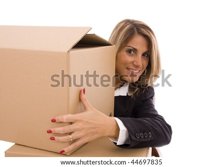 Beautiful woman looking behind a cardboard box - stock photo