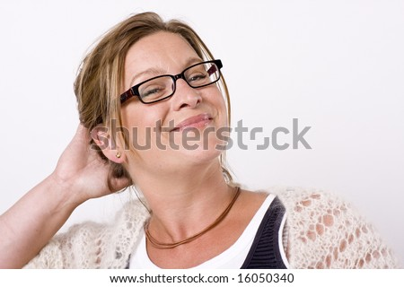 Beautiful woman looking into camera with a friendly, seductive smile - stock photo