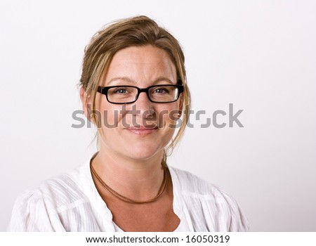Beautiful woman looking into camera with a friendly smile - stock photo