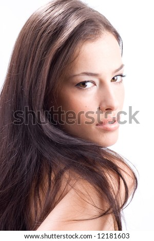 beautiful woman looking over shoulder, studio shot - stock photo