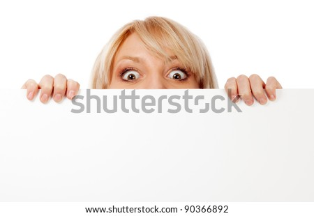 Beautiful woman looking surprised and scared. Isolated over white. - stock photo