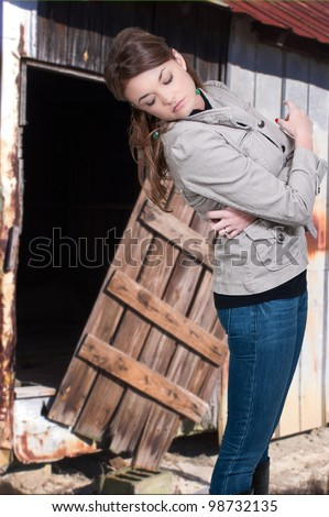 Beautiful woman looking to see how her clothes look - stock photo