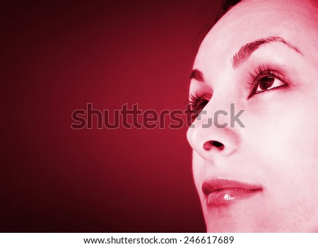 Beautiful woman looking up isolated on black backgound.  - stock photo