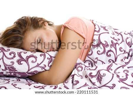 Beautiful woman lying and sleep on the snowy bed. - stock photo