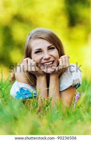 beautiful woman lying meadow grass summer park smiling