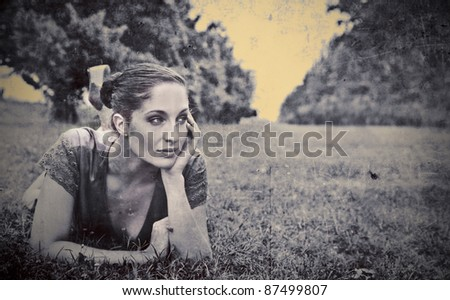 Beautiful woman lying on a meadow - stock photo