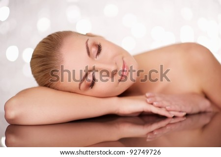 Beautiful woman lying on a table.
