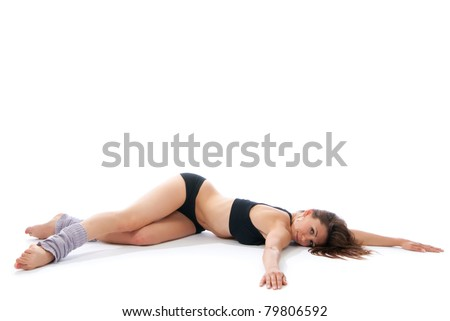 Beautiful woman lying on floor doing yoga pose on a white background