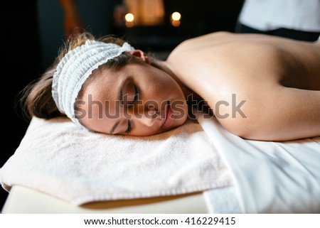 Beautiful woman lying on massage table and relaxing - stock photo
