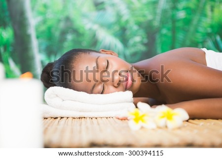 Beautiful woman lying on massage table at the health spa - stock photo
