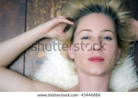 beautiful woman lying on rug
