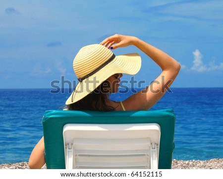 Beautiful woman lying on the beach - stock photo