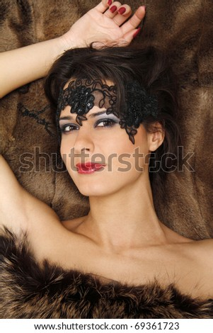 beautiful woman lying on the fur