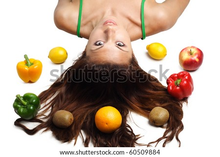 Beautiful woman lying with fruits and hair is dishevelled isolated - stock photo