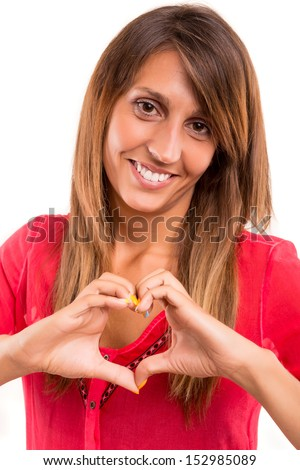 Beautiful woman making a heart shape with her hands, isolated over white background - stock photo