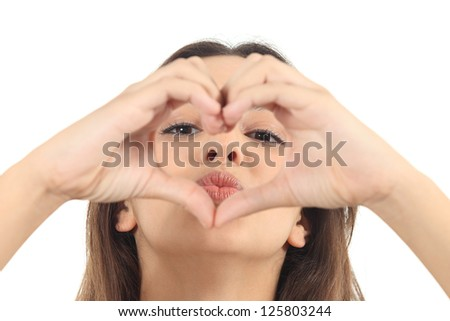 Beautiful woman making a heart shape with her hands on a white isolated background