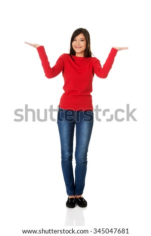 Beautiful woman making a scale with her arms wide open. - stock photo