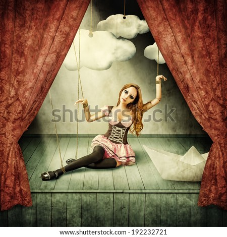 Beautiful woman marionette on stage puppet theater - stock photo