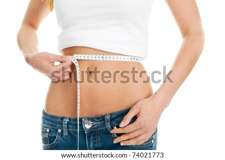 Beautiful woman measuring waist. Isolated on white - stock photo