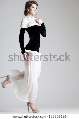 beautiful woman model posing in elegant dress in the studio - stock photo