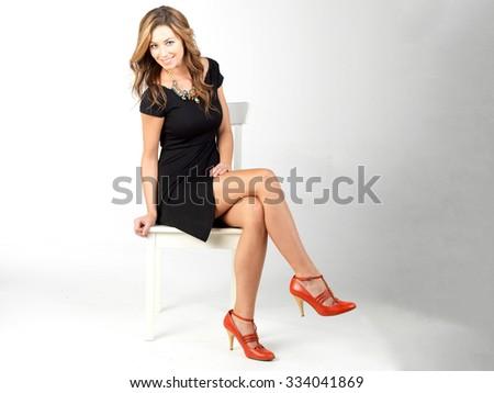 beautiful woman model posing in elegant dress in the studio.High fashion model posing. - stock photo