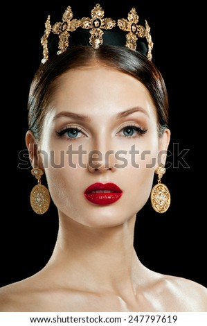 Beautiful woman model with professional makeup, in jewelry. Golden Crown. Red lipstick. - stock photo